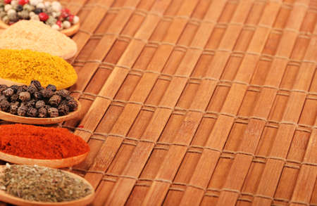 Group of indian spices and herbs difference ware in wooden spoons on wooden background with normal view and copy space for design foods, vegetable, spices, herbs, healthy lifestyle or other your content. Standard-Bild - 120876580