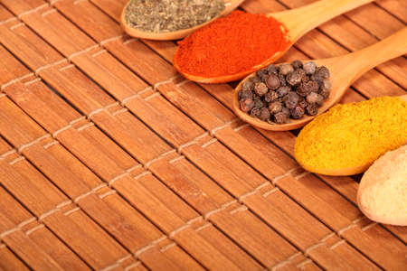Group of indian spices and herbs difference ware in wooden spoons on wooden background with normal view and copy space for design foods, vegetable, spices, herbs, healthy lifestyle or other your content. Banque d'images
