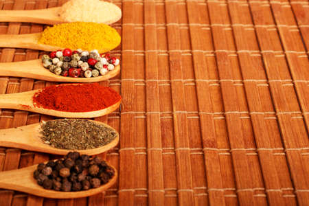 Group of indian spices and herbs difference ware in wooden spoons on wooden background with normal view and copy space for design foods, vegetable, spices, herbs, healthy lifestyle or other your content. Standard-Bild - 120876632