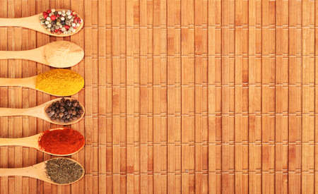 Group of indian spices and herbs difference ware in wooden spoons on wooden background with top view and copy space for design foods, vegetable, spices, herbs, healthy lifestyle or other your content. Standard-Bild - 120876660