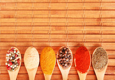 Group of indian spices and herbs difference ware in wooden spoons on wooden background with top view and copy space for design foods, vegetable, spices, herbs, healthy lifestyle or other your content. Standard-Bild - 120876685