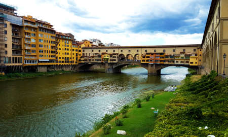 Panotamic view of the Ponte Vecchio, a medieval bridge over the river Arno in the city of Florence, Italy