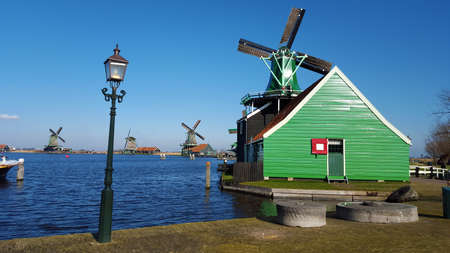 Zaanse Schans is a neighbourhood of Zaandam in the municipality of Zaanstad in the Netherlands. It has a collection of well-preserved historic windmills
