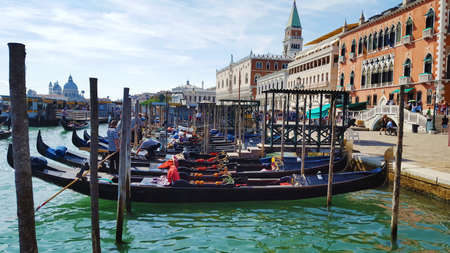 View from the Canal di San Marco on Doges Palace and the Campanile in Venice, Italy. Gondolas moored by Saint Mark square. Architecture and landmarks of Venice