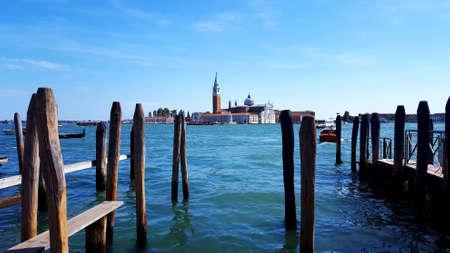 Classic view across the water towards Church of San Giorgio Maggiore, Venice, Italy. Scenic view of the Venetian Lagoon.