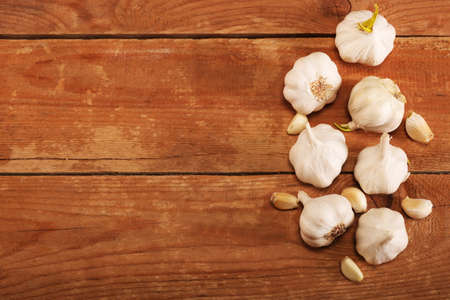 Garlic Cloves and Bulb on vintage wooden rustic table. Top view. Place for text, copy space