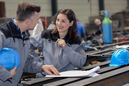 Happy female worker agrees with male colleague