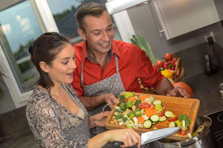 vegetarian couple preparing their meal