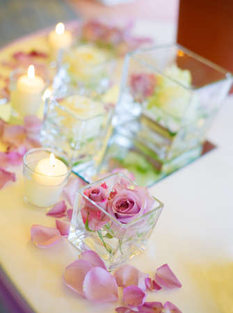 incandescence: vase of pink roses and candles