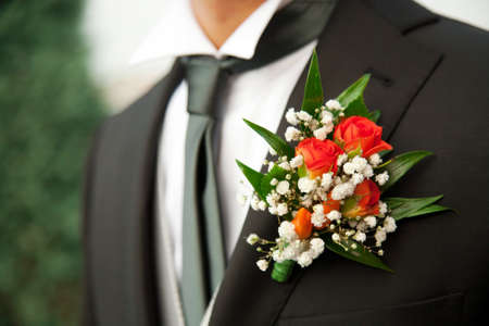 buttonhole: Bridegroom with a white flower decoration Stock Photo