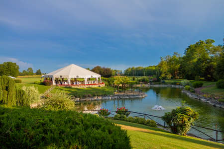 beautiful location: Outdoor wedding reception in tent