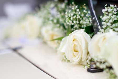 Luxury wedding white car decorated with roses Stock Photo