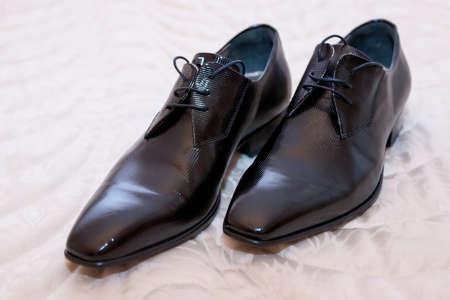 elegant groom black shoes photo