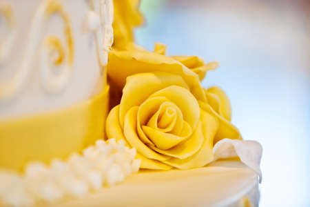 beautiful white nuptial cake with flowers photo