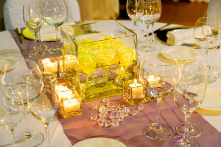 Tables decorated of flowers  for a party or wedding reception photo