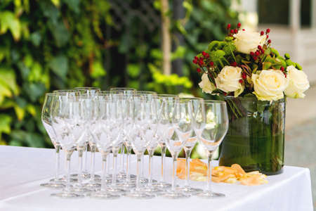 Wedding glass on table with vase of flowers