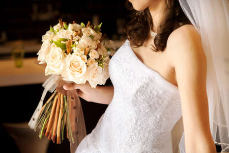 fancy dress costume: Close-up of bride holding  roses bouquet