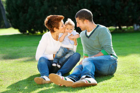 Family playing on grass in the park