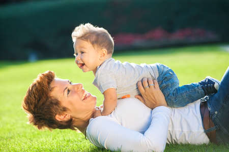 Mother with baby playing in the park photo