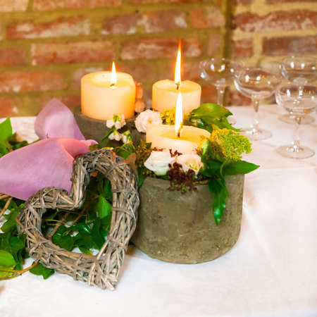 vases of candles on the table photo