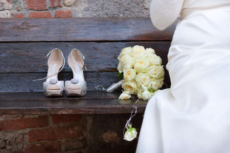 beautiful  shoes and bouquet from bride photo