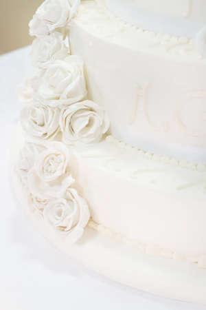 cake tier: beautiful white nuptial cake with flowers