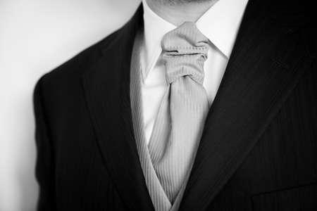 Groom in elegant black wedding dress