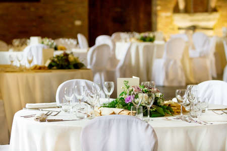 Tables decorated for a party or wedding reception photo