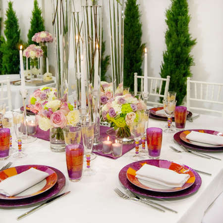 meal preparation: Tables decorated for a party or wedding reception