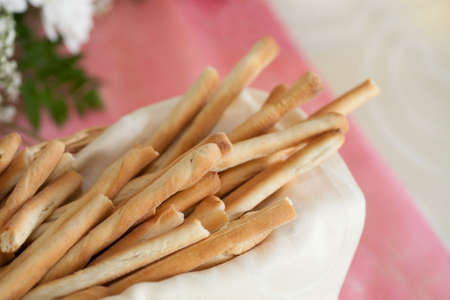 breadstick: basket of breadstick and bread to slices