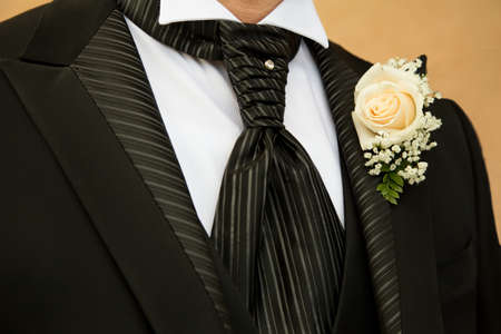 Groom in elegant black dress photo