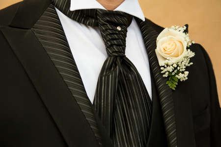 buttonhole: Groom in elegant black dress