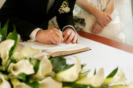 wedding accessories: groom  write on registration of marriage