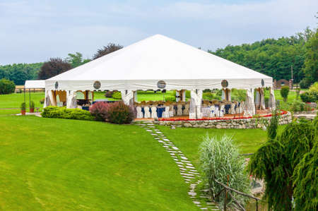 Outdoor wedding reception in tent