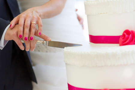 cut wedding cake  photo