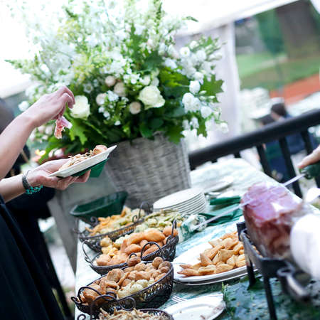 Buffet on a long table with appetizers or finger food photo