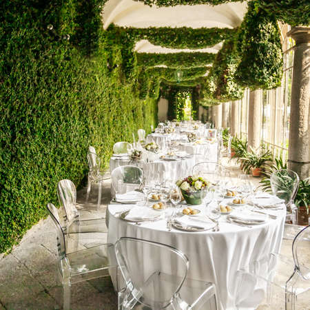 eating in the garden: Tables decorated for a party or wedding reception