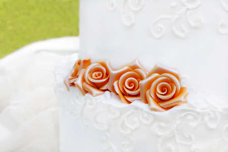 White wedding cake with roses  photo