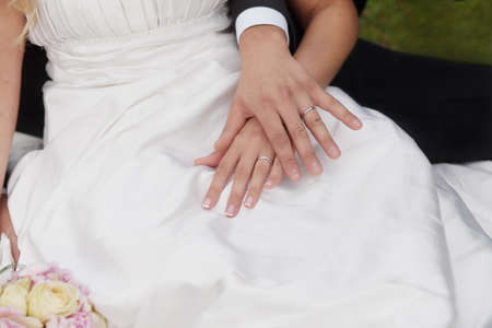 bride and groom hands with gold wedding rings  photo