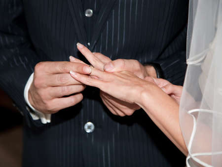 Couple having their wedding ceremony in church photo