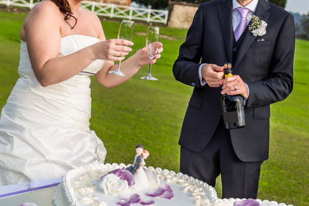affiance: champagne in hands of bride and groom Stock Photo