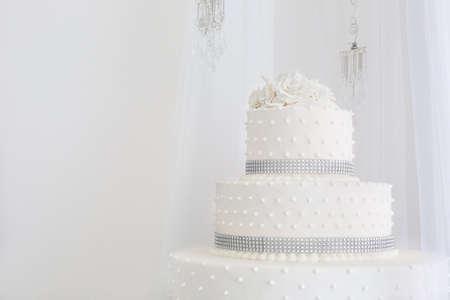 eating cake: white floral wedding cake