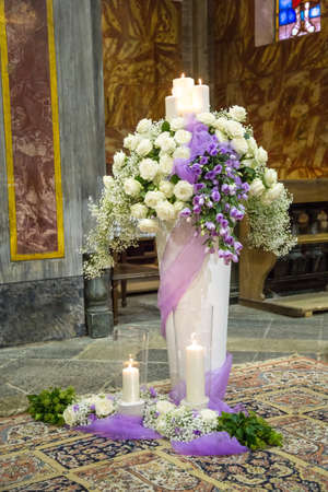 catholic wedding: Beautiful flower wedding decoration in a church during catholic wedding ceremony Stock Photo