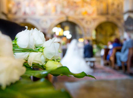promised: Beautiful flower wedding decoration in a church during catholic wedding ceremony Editorial