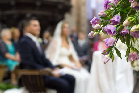 sacerdote: Beautiful flower wedding decoration in a church during catholic wedding ceremony Foto de archivo