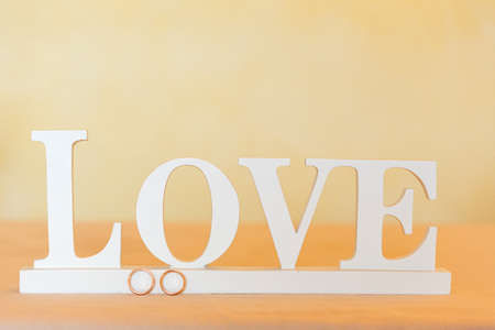scribe: Word LOVE created of wood letters white