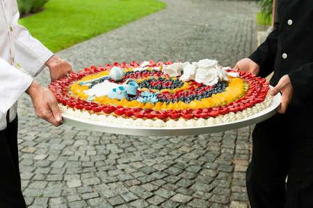 waiter serving: waiter serving wedding cake