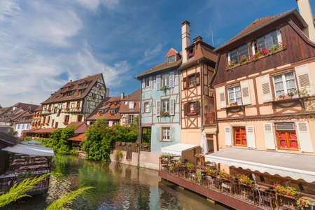 timbered: Colmar, Petit Venice, water canal and timbered houses. Alsace, France.