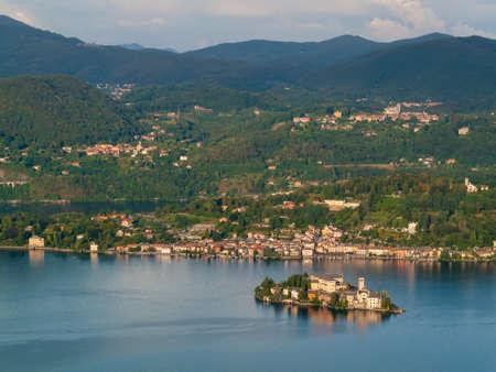 orta: View of Lake Orta and San Giulio island in Piedmont Italy Stock Photo
