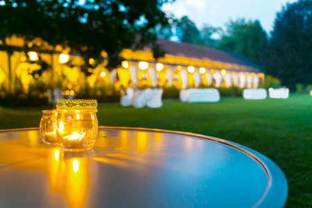 Outdoor wedding reception in tent